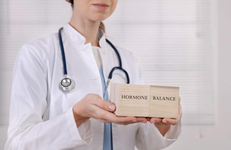 """Doctor holding blocks saying """"hormone balance"""""""